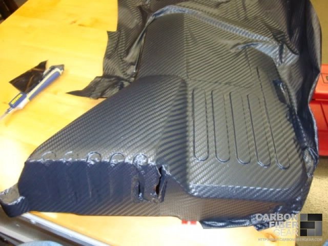 Fenders being wrapped in 3M carbon fiber film