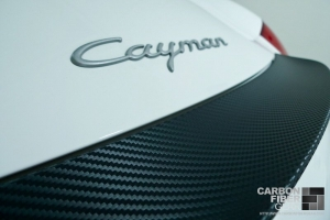 White Porsche Cayman with carbon fiber 3M DI-NOC