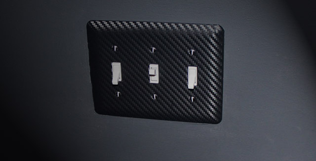 Lightswitch plate with carbon fiber 3M DI-NOC installed